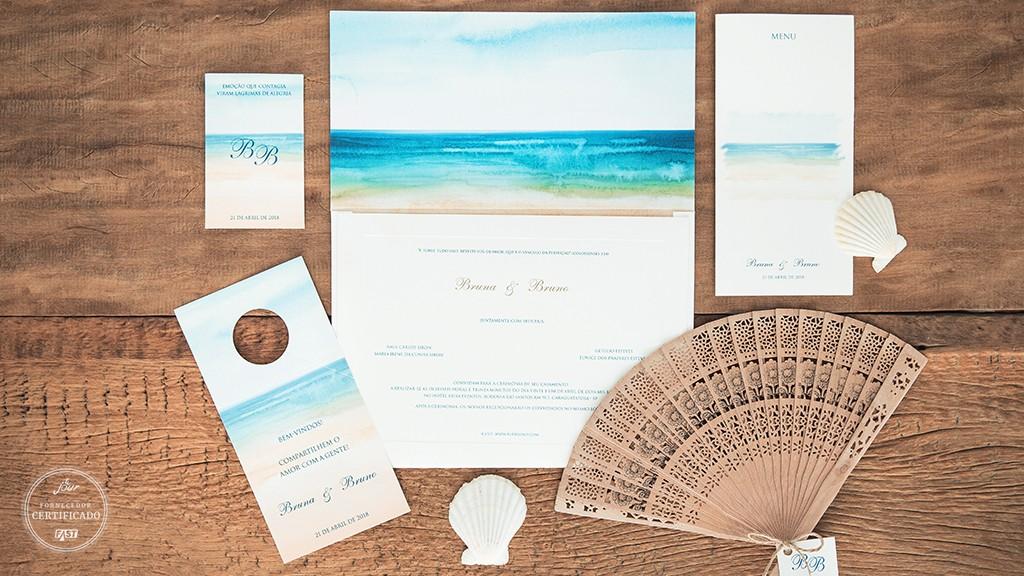Convite com ilustração customizada para casamento na praia.